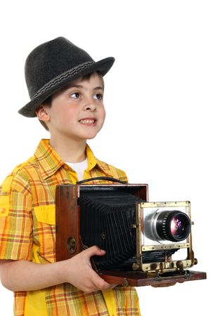 Little boy with an old camera on a white background photo