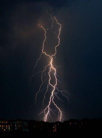 Lightning a thunderstorm, nightly cloudy sky photo