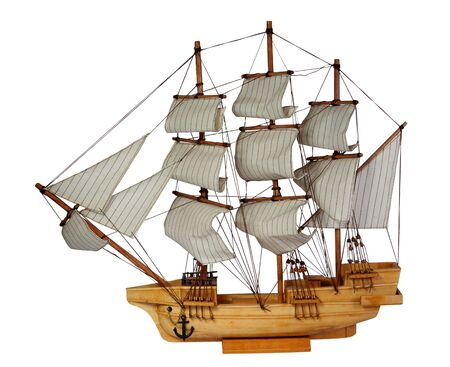 Model of ship with sails on a white background photo
