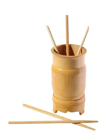 Wooden bamboo glass with the chopsticks on a white background photo