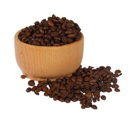 Coffee in a wooden mortar on a white background photo