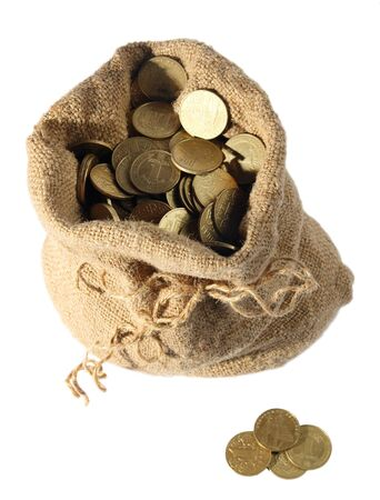 Sackful of change money, coins on a white background photo