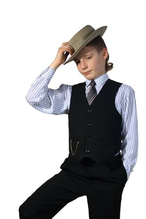 Boy in a grey hat and in a black suit on a white background photo