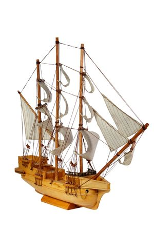 Model of ship with sails on a white background. (isolated)