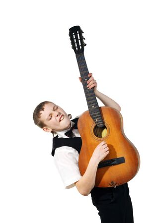Boy in a black suit and with an old guitar on a white background photo