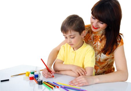 Little boy with crayons on a white background photo
