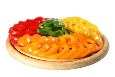 Red yellow orange green pepper on a chopping board. (isolated) photo