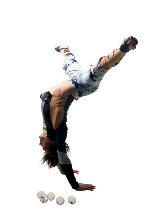 adroitness: acrobat stands on hands on a white background