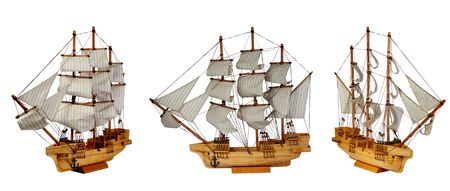 Model of ship with sails on a white background. (isolated) photo