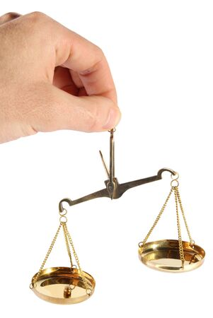 Old scales in a hand on a white background Stock Photo - 5136665