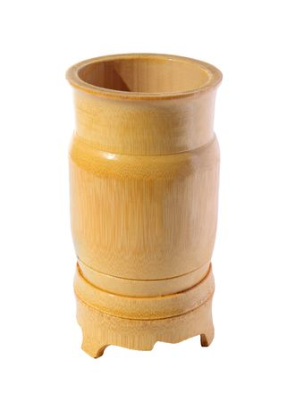 Wooden bamboo glass on a white background photo