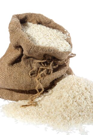 asian produce: Sackful of rice, spilled, on a white background