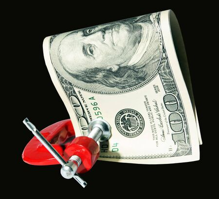 Money clamped in the clamp on the Black background. (isolated) photo