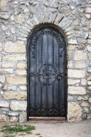 Texture of the old walls and wrought iron doors photo