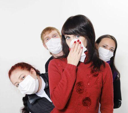 Personas en m�scaras, enferma de gripe Foto de archivo - 5820768