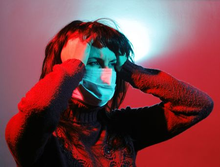 Girl with a headache, suffering from flu, A(H1N1) photo