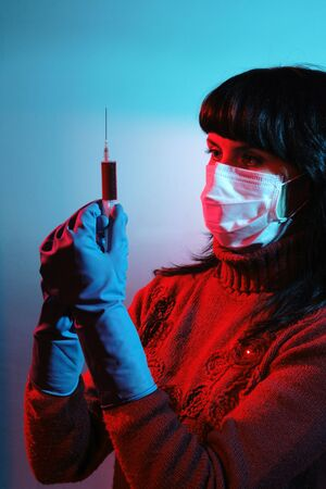 Medicine doctor with medical syringe in hands, A(H1N1) photo