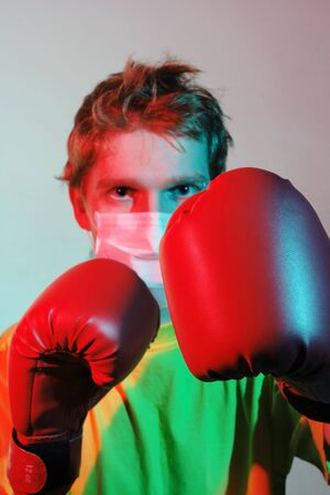 Doctor in red boxing gloves fighting against influenza, A(H1N1) photo