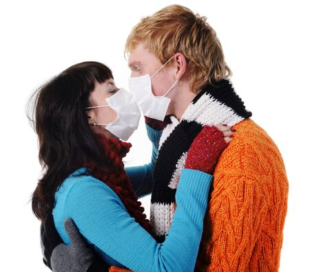 Man and woman wearing masks kissing, flu, A(H1N1) photo