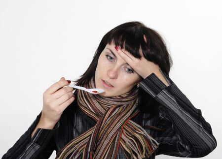 ah1n1: Girl with a headache, suffering from flu, A(H1N1), on the grey background