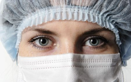 nurse cap: face of the doctor in a mask closeup Stock Photo
