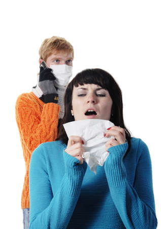 ah1n1: girl was ill of influenza, a man stands behind a mask, said by telephone, A(H1N1),  Stock Photo