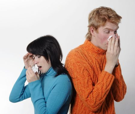 Sick flu man and woman, sneeze on each other, A(H1N1), on the white grey background photo