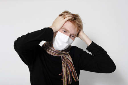 ah1n1: Man with a headache, suffering from flu, A(H1N1), on the grey background