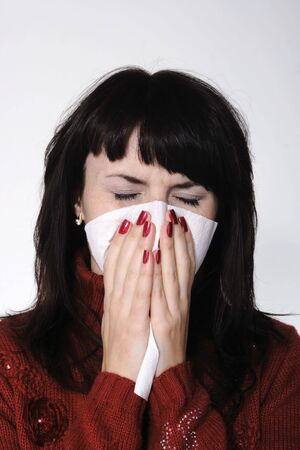 Girl with a headache, suffering from flu, A(H1N1), on the grey background photo