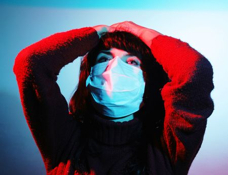 Girl with a headache, suffering from flu, A(H1N1), an abstract color environment photo