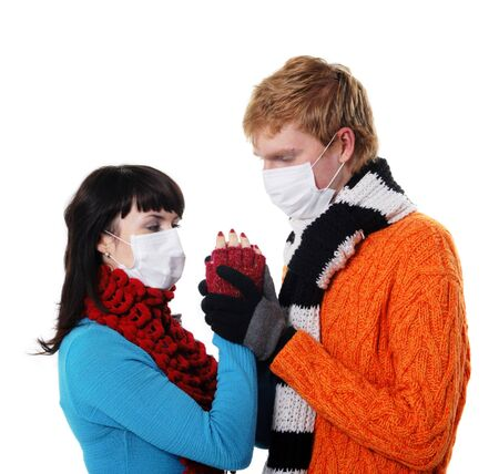 ah1n1: man embraces a woman wearing masks, flu, A(H1N1), on the white background Stock Photo