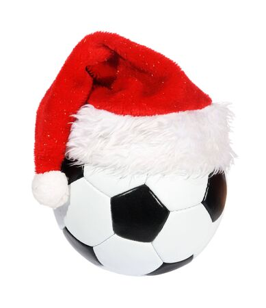 Santa Claus hat on the soccer ball Stock Photo - 6021832