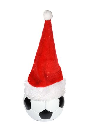 Santa Claus hat on the soccer ball Stock Photo - 6021824