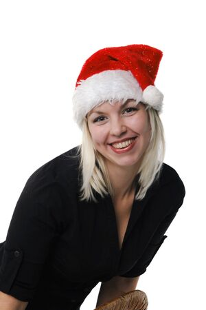 Young girl in a Santa Claus hat on the white background Stock Photo - 6059171
