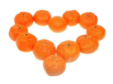 Mandarins in the form of heart on the white background, to the day of Sainted Valentine Stock Photo - 6220392