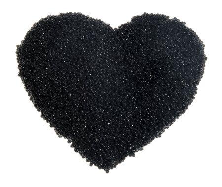 caviar negro en forma de coraz�n en el fondo blanco, para el d�a de San Valent�n Sainted Foto de archivo - 6298381