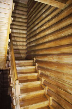 brown wooden staircase in a wooden house photo