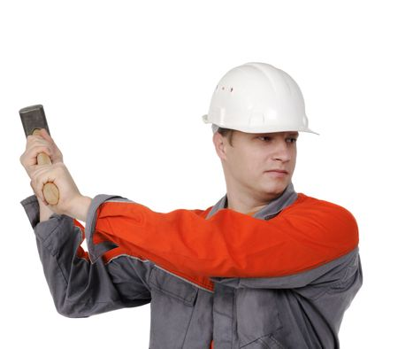man in overalls with a hammer in his hands, the builder on the white background photo