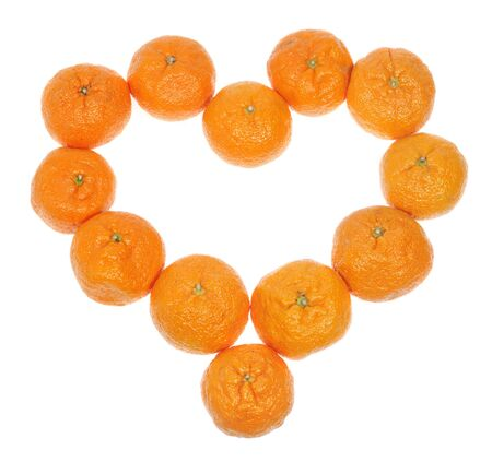 Mandarins in the form of heart on the white background, to the day of Sainted Valentine photo
