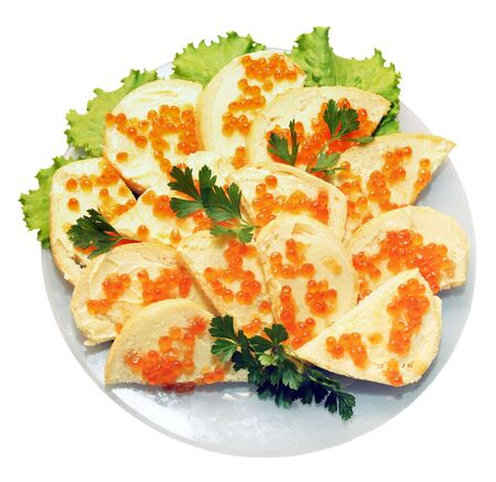 Sandwich with red caviar on the plate on the white background photo