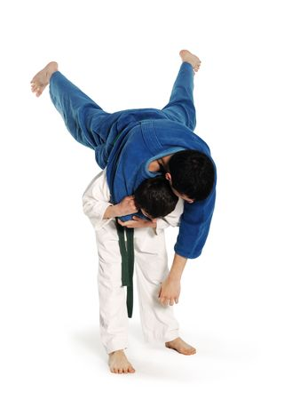 Judo fighting competition on the white background Imagens