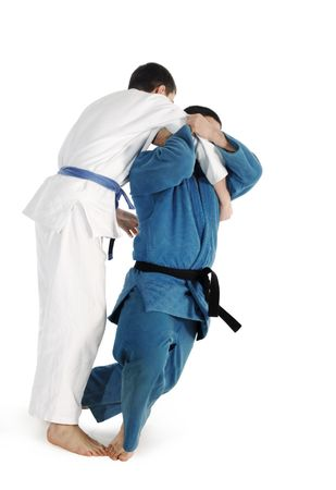 judo: Lucha contra la competencia sobre el fondo blanco de Judo