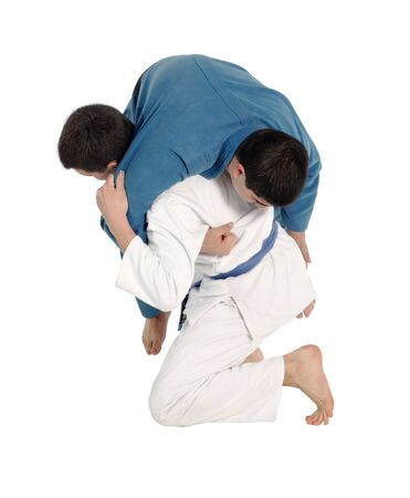 Judo fighting competition on the white background Stock Photo