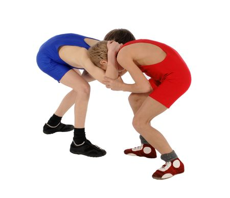 two wrestlers Greco-Roman wrestling on the white background