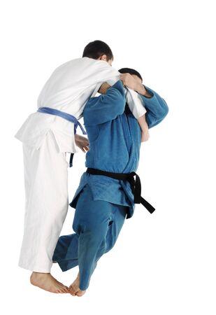 judo: Judo, lucha contra la competencia sobre el fondo blanco  Foto de archivo