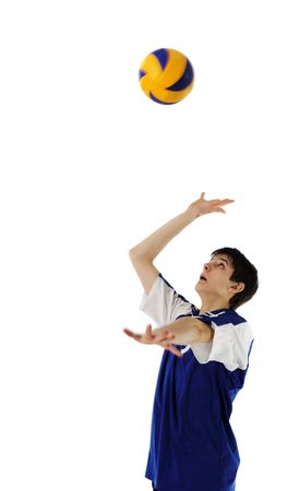 Volleyball player in high flying with a ball �n the white background