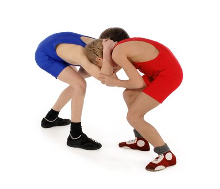 wrestle: two wrestlers Greco-Roman wrestling on the white background