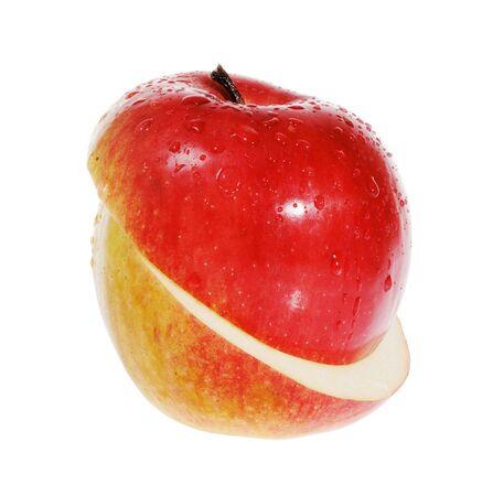 slit: Manzana roja sobre el fondo blanco de hendidura  Foto de archivo