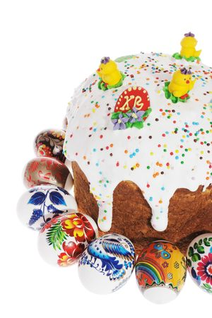 Russian Easter cake and colourful easter eggs isolated on the white background  photo
