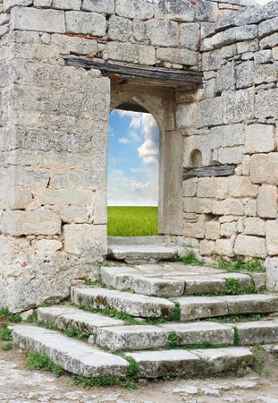Old stone entrance to the green field photo